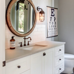 Small farmhouse kids' white tile and porcelain tile porcelain floor and gray floor bathroom photo in Portland with shaker cabinets, white cabinets, a one-piece toilet, multicolored walls, an undermount sink, engineered quartz countertops and a hinged shower door