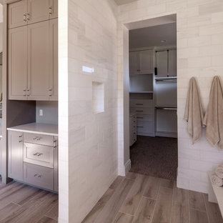 Inspiration for a large cottage master white tile and marble tile porcelain tile and brown floor bathroom remodel in Portland with shaker cabinets, beige cabinets, a one-piece toilet, multicolored walls, an undermount sink and quartz countertops