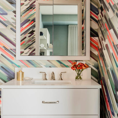 Bathroom - contemporary bathroom idea in Boston with flat-panel cabinets, white cabinets, multicolored walls, an undermount sink and white countertops
