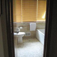 Mediterranean Bathroom by E. V. JAMES CO., INC. MASTER REMODELORS-BUILDERS