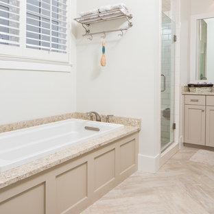 Bild på ett mellanstort vintage en-suite badrum, med luckor med infälld panel, beige skåp, ett badkar i en alkov, en dusch i en alkov, en toalettstol med separat cisternkåpa, beige kakel, keramikplattor, grå väggar, klinkergolv i keramik, ett undermonterad handfat och granitbänkskiva