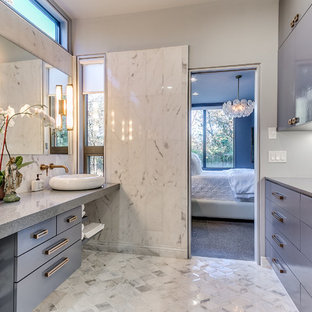 Inspiration for a mid-sized contemporary master bathroom in Oklahoma City with flat-panel cabinets, blue cabinets, gray tile, grey walls, marble floors, a vessel sink, marble, engineered quartz benchtops and multi-coloured floor.
