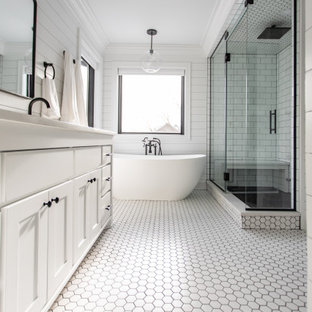 Bathroom - large farmhouse master white tile and subway tile ceramic tile, white floor, double-sink and shiplap wall bathroom idea in Minneapolis with shaker cabinets, white cabinets, a two-piece toilet, white walls, an undermount sink, quartz countertops, a hinged shower door, white countertops and a built-in vanity
