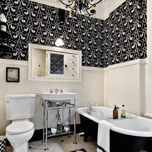 Example of a classic claw-foot bathtub design in Chicago with a console sink and beige walls
