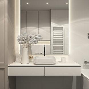 Exemple d'une salle de bain tendance de taille moyenne pour enfant avec un placard avec porte à panneau encastré, des portes de placard beiges, une baignoire posée, un combiné douche/baignoire, un WC séparé, un carrelage blanc, des carreaux de céramique, un mur blanc, un sol en carrelage de céramique, un lavabo posé, un plan de toilette en bois, un sol noir, une cabine de douche avec un rideau, un plan de toilette blanc, buanderie, meuble simple vasque, meuble-lavabo encastré et un plafond à caissons.