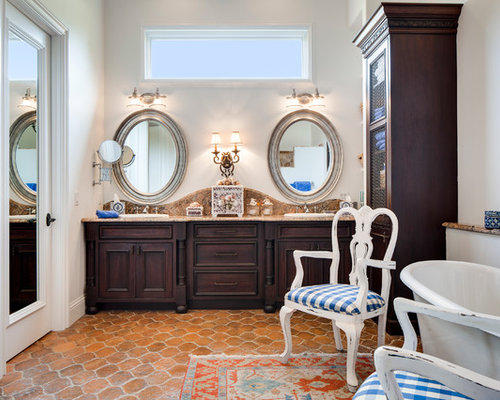tuscan master bathroom photo in miami with a dropin sink