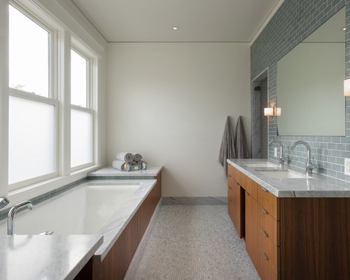 inspiration for a gray tile and subway tile mosaic tile floor bathroom remodel in san