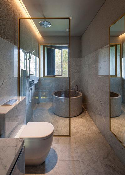 Modern Bathroom by ipli Architects