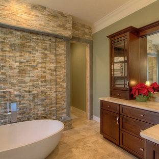 Example of an arts and crafts master stone tile travertine floor bathroom design in Atlanta with shaker cabinets, dark wood cabinets, an undermount sink and granite countertops