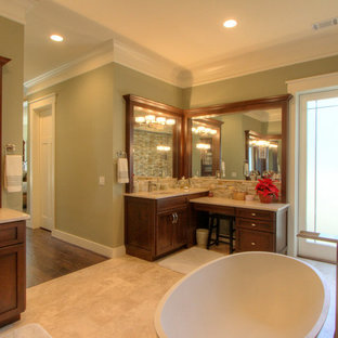 Arts and crafts master stone tile travertine floor bathroom photo in Atlanta with shaker cabinets, dark wood cabinets, an undermount sink and granite countertops