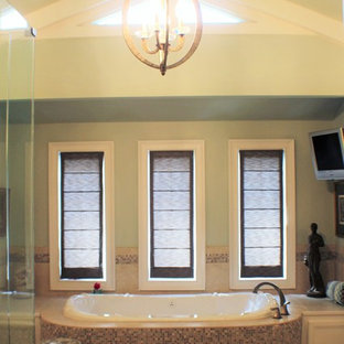 Example of a large trendy master beige tile and ceramic tile ceramic tile drop-in bathtub design in Atlanta with shaker cabinets, white cabinets, green walls, an undermount sink and granite countertops