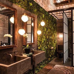 Bathroom - industrial dark wood floor bathroom idea in Denver with a two-piece toilet and a wall-mount sink