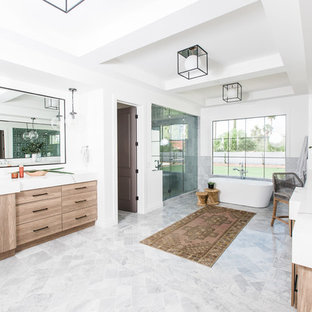 Example of a large tuscan master gray floor bathroom design in Phoenix with flat-panel cabinets, beige cabinets, white walls, an undermount sink, a hinged shower door and white countertops