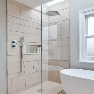 Example of a trendy beige tile bathroom design in London with gray walls