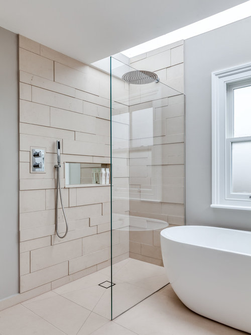 Example of a danish beige tile bathroom design in London with gray walls