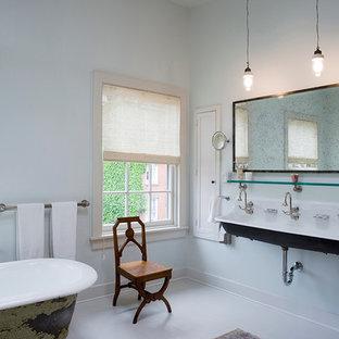 Claw-foot bathtub - transitional claw-foot bathtub idea in New York with a trough sink and blue walls