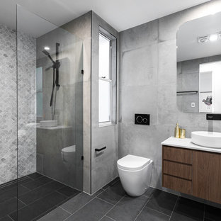 Inspiration for a contemporary 3/4 bathroom in Brisbane with flat-panel cabinets, dark wood cabinets, an alcove shower, a one-piece toilet, grey walls, a vessel sink, grey floor, an open shower and white benchtops.