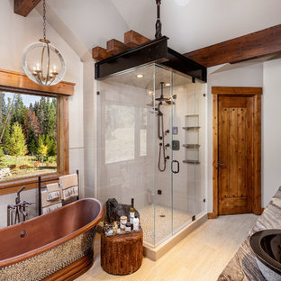 Inspiration for a rustic freestanding bathtub remodel in Denver with a vessel sink