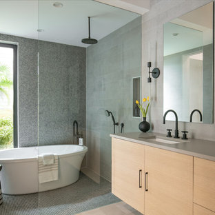 Example of a trendy master gray floor and mosaic tile floor bathroom design in Tampa with flat-panel cabinets, light wood cabinets, an undermount sink, brown walls and gray countertops