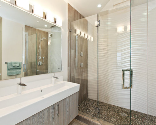 Example Of A Trendy Pebble Tile Floor Alcove Shower Design In San Francisco With Trough