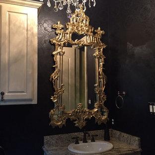 Imagen de cuarto de baño con ducha, asiático, pequeño, con paredes negras, suelo de travertino, armarios con paneles con relieve, puertas de armario blancas, lavabo encastrado y encimera de granito