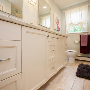 Inspiration for a mid-sized contemporary kids' white tile and ceramic tile ceramic tile and beige floor walk-in shower remodel in Boston with raised-panel cabinets, white cabinets, a one-piece toilet, white walls, an undermount sink, quartz countertops, a hinged shower door and beige countertops