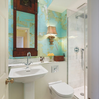 Example of a trendy white tile mosaic tile floor alcove shower design in London with a pedestal sink, a wall-mount toilet and multicolored walls