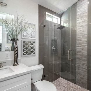 Inspiration for a mid-sized craftsman master gray tile and porcelain tile porcelain floor and gray floor bathroom remodel in San Francisco with shaker cabinets, white cabinets, a one-piece toilet, white walls, an undermount sink, quartz countertops, white countertops and a built-in vanity