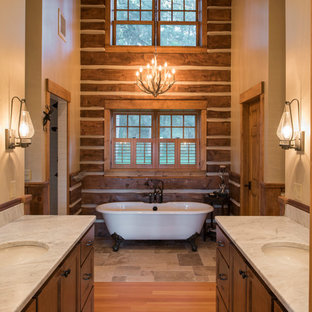This is an example of a medium sized rustic bathroom in Minneapolis with recessed-panel cabinets, a claw-foot bath, a two-piece toilet, white tiles, metro tiles, beige walls, a submerged sink, marble worktops, brown floors, an open shower, medium wood cabinets and medium hardwood flooring.