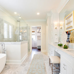 Inspiration for a large traditional master bathroom in Birmingham with beaded inset cabinets, white cabinets, a freestanding tub, a corner shower, white tile, marble, white walls, marble floors, an undermount sink, marble benchtops, yellow floor, a hinged shower door and white benchtops.
