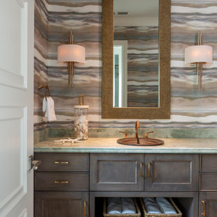 Tuscan gray floor, single-sink and wallpaper bathroom photo in Miami with brown cabinets, multicolored walls, gray countertops and a built-in vanity