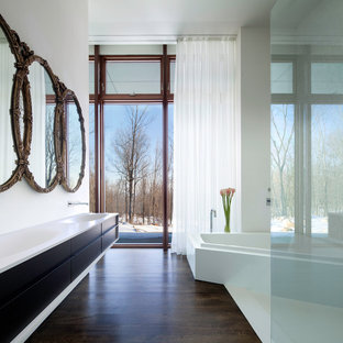 Design ideas for a modern bathroom in New York with an integrated sink.