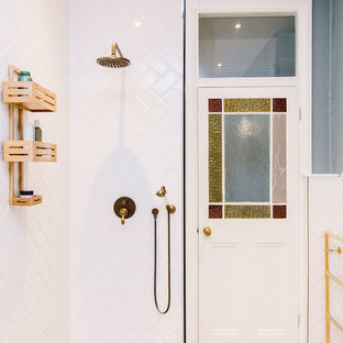 Mid-sized trendy white tile and subway tile laminate floor and beige floor bathroom photo in London with blue walls