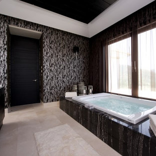 Example of a large eclectic master black tile bathroom design in Other with black cabinets, a hot tub and black walls