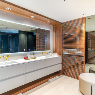 Inspiration for a large contemporary master white tile porcelain tile, double-sink and beige floor bathroom remodel in Miami with flat-panel cabinets, white cabinets, white walls, an undermount sink, quartz countertops, a floating vanity and white countertops