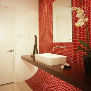 Small trendy red tile and glass tile bathroom photo in Houston with a vessel sink, wood countertops and white walls
