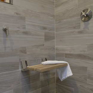 Double shower - mid-sized modern master brown tile and porcelain tile porcelain floor and brown floor double shower idea in New York with furniture-like cabinets, gray cabinets, a one-piece toilet, white walls, an undermount sink, glass countertops and a hinged shower door