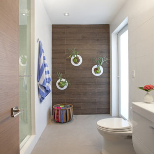 Minimalist brown tile alcove shower photo in Miami with white cabinets and a one-piece toilet