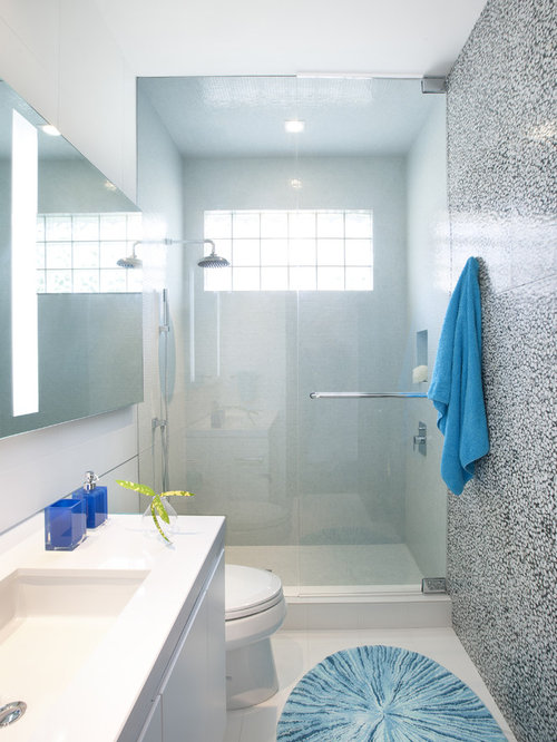 example of a trendy multicolored tile alcove shower design in miami with an undermount sink