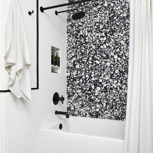 Inspiration for a small modern kids' alcove bathtub remodel in DC Metro with flat-panel cabinets, white cabinets, a one-piece toilet, white walls and quartzite countertops