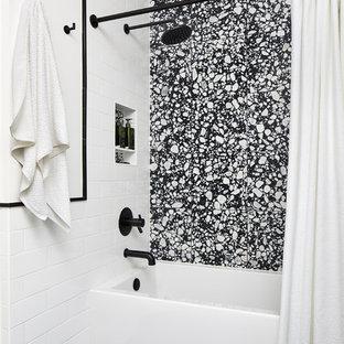 ワシントンD.C.の小さいモダンスタイルのおしゃれな子供用バスルーム (フラットパネル扉のキャビネット、白いキャビネット、アルコーブ型浴槽、一体型トイレ、白い壁、珪岩の洗面台) の写真