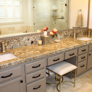 Example of a large transitional master beige tile and travertine tile travertine floor and beige floor corner shower design in Los Angeles with raised-panel cabinets, beige cabinets, a hot tub, a two-piece toilet, beige walls, an undermount sink, granite countertops and a hinged shower door
