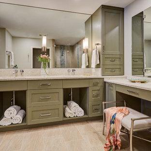 Modelo de cuarto de baño principal, tradicional renovado, de tamaño medio, con armarios con paneles empotrados, puertas de armario verdes, ducha esquinera, baldosas y/o azulejos beige, paredes grises, suelo de baldosas de porcelana, lavabo bajoencimera, encimera de terrazo, suelo beige, ducha con puerta con bisagras y encimeras beige