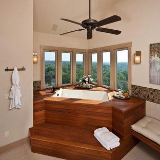 Imagen de cuarto de baño rústico con bañera encastrada sin remate