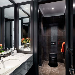 Design ideas for a contemporary bathroom in Sydney with black tile, black walls, an undermount sink, an alcove shower, a one-piece toilet, marble, marble floors, marble benchtops, brown floor and white benchtops.