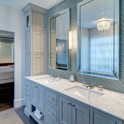Example of a large classic master blue tile and glass tile porcelain tile freestanding bathtub design in Atlanta with an undermount sink, recessed-panel cabinets, blue cabinets, granite countertops and white walls