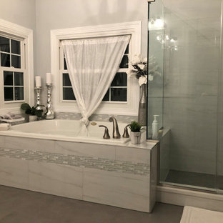 Example of a mid-sized transitional master gray tile and marble tile yellow floor and double-sink bathroom design in Baltimore with shaker cabinets, white cabinets, a two-piece toilet, gray walls, an undermount sink, quartz countertops, white countertops and a built-in vanity