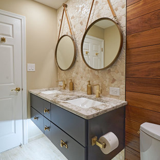 This is an example of a mid-sized contemporary kids bathroom in Philadelphia with flat-panel cabinets, an alcove shower, beige tile, porcelain tile, beige walls, porcelain floors, an undermount sink, engineered quartz benchtops, beige floor, beige benchtops, a double vanity, a floating vanity, grey cabinets and wood walls.