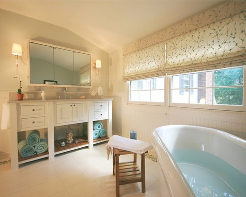 Example Of A Classic Freestanding Bathtub Design In Chicago With White Cabinets And Shaker