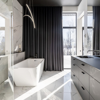 Large minimalist master black and white tile and ceramic tile ceramic tile, multicolored floor and double-sink bathroom photo in New York with black cabinets, multicolored walls, a drop-in sink, quartz countertops and black countertops